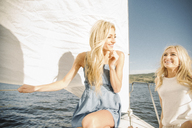 Portrait of two blond sisters on a sail boat. - MINF03877
