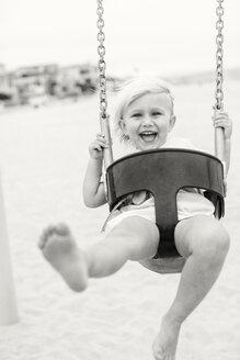 Black & white shot of girl on swing - ISF19637