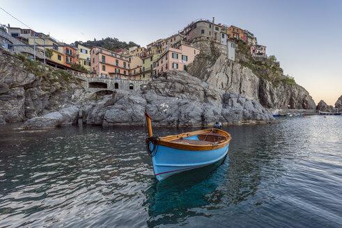 Italy, Liguria, La Spezia, Cinque Terre National Park, Manarola, empty blue fishing boat - RPSF00218