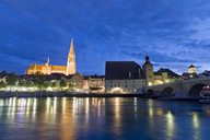 Germany, Bavaria, Regensburg, Old town, Regensburg Cathedral and Danube river at blue hour - KLRF00658