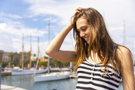 Smiling young woman at a marina - WPEF00762