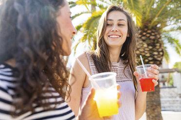 Two happy female friends enjoying a fresh slush - WPEF00768