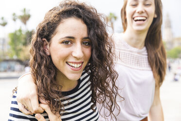 Portrait of two happy female friends outdoors - WPEF00780
