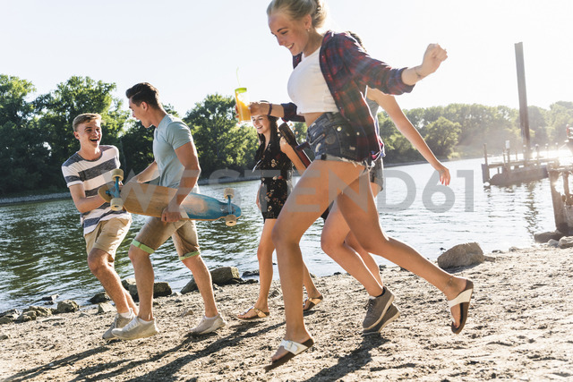 Group of happy friends having fun at the riverside - UUF14883