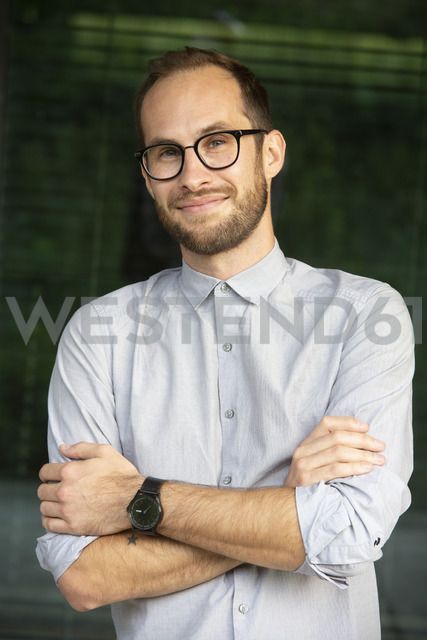 Portrait of relaxed businessman wearing glasses - NGF00461