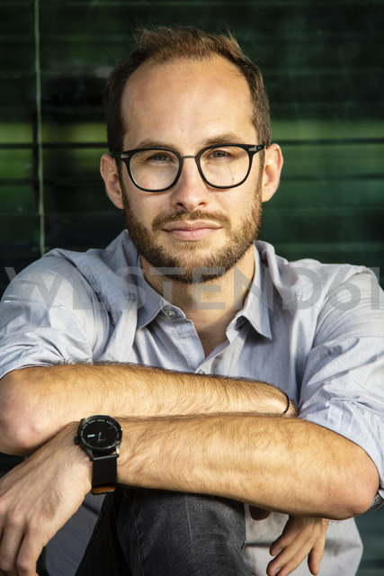 Portrait of serious businessman wearing glasses - NGF00473