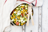 Lunch box of salad with chick peas roasted with curcuma, feta, cucumber, tomatoes and parsley - LVF07371