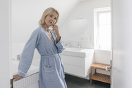 Portrait of mature woman in bathroom - JOSF02485
