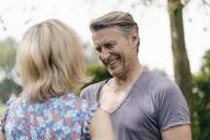 Happy mature man smiling at woman - JOSF02521