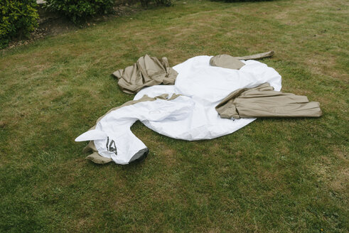 Empty inflatable pool toy on lawn - JOSF02533