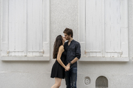 Young couple in love kissing in front of building - AFVF01248