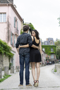 France, Paris, young couple in an alley in the district Montmartre - AFVF01251