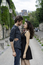 France, Paris, young couple in an alley in the district Montmartre - AFVF01254