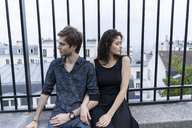 France, Paris, young couple having a break in the district Montmartre - AFVF01263