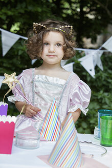 Young girl dressed as a fairy at a garden party. - MINF04877