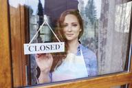 Portrait of young woman closing a shop - ABIF00812