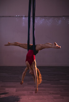 Aerial silks performer during a performance - MAUF01676
