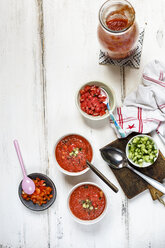 Two bowls of Gazpacho and bowls of toppings - SBDF03724