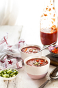 Bowl of Gazpacho with cucumber and bell pepper topping - SBDF03727