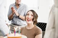 Female office worker receiving birthday cake - CUF43774