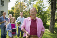 A family summer gathering at a farm. A shared meal, a homecoming. - MINF04941