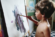 A boy, child painting at an easel. - MINF05037