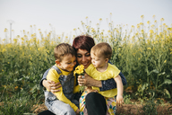 Happy mother with little son and daughter in nature - JRFF01787