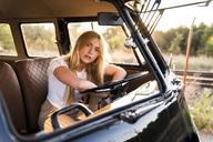 Portrait of young woman in a van - KKAF01385