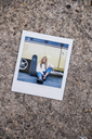 Instant photo of young woman with skateboard sitting at a vintage van - KKAF01400