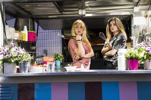 Portrait of two young women in a food truck - KKAF01406