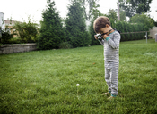 Boy, child photographing a dandelion with a camera. - MINF05115
