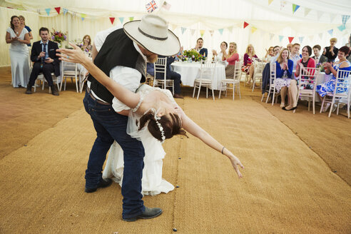 Bride and groom dancing together inside a marquee. - MINF05511