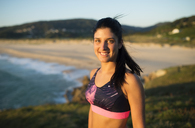 Portrait of an athlete woman in the evening, beach in the background - RAEF02067