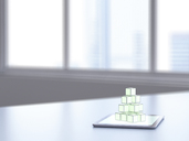 3D rendering, Pile of cubes on digital tablet on desk - UWF01494