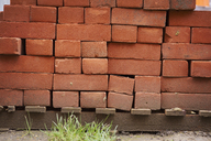 Stack of red bricks on a building site. - MINF05525