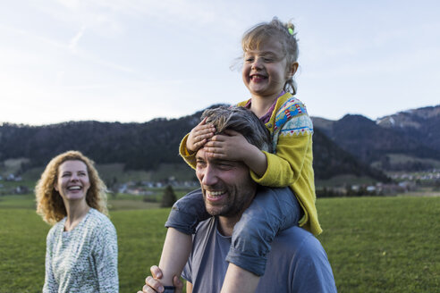 Austria, Tyrol, Walchsee, happy family hiking on an alpine meadow - JLOF00218