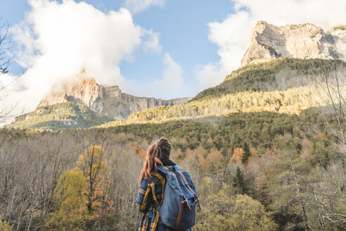 Spain, Ordesa y Monte Perdido National Park, back view of woman with backpack looking at view - AFVF01298