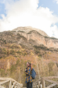 Spain, Ordesa y Monte Perdido National Park, laughing woman with backpack in autumn - AFVF01301