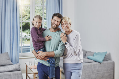 Portrait of happy parents with daughter at home - RORF01383