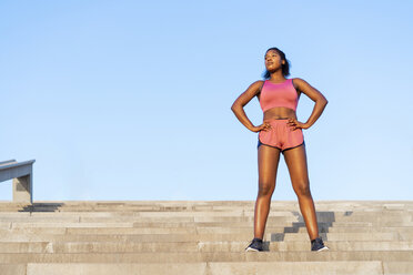 Young woman during workout on stairs - AFVF01314
