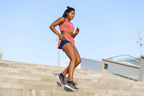 Young woman during workout on stairs - AFVF01317
