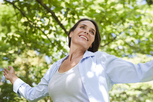 Portrait of relaxed mature woman dancing in nature - PNEF00857
