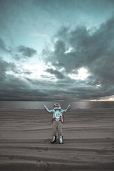 Spaceman standing alone at lake on nameless planet, with raised arms - VPIF00461