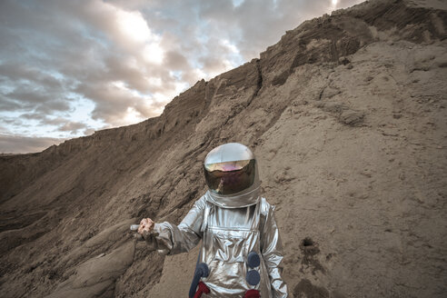 Spaceman on a nameless planet, taking rock samples - VPIF00491