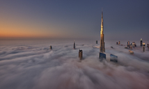 View of the Burj Khalifa and other skyscrapers above the clouds in Dubai, United Arab Emirates. - MINF06516