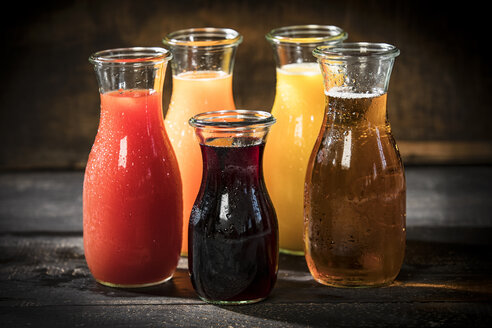 Glass bottles of various fruit juices - MAEF12684