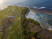 Indonesia, Bali, Aerial view of golf course with bunker and green at coast - KNTF01173