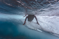 Maledives, Indian Ocean, surfer sitting on surfboard, underwater shot - KNTF01209