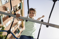 Portrait of little girl on climbing frame - JSMF00397