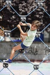 Portrait of smiling little girl on climbing frame - JSMF00406